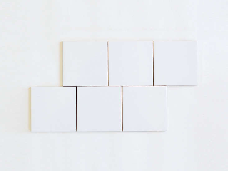 Mimic the kitchen's white tile with Daltile Semi-Gloss White Ceramic Wall Tile in 4 loading=