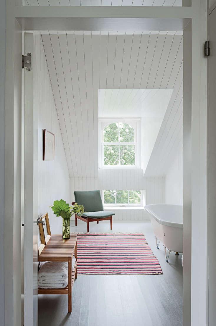 a scandi style attic bathin brooklyn gets a dose of color via a striped rug;  9