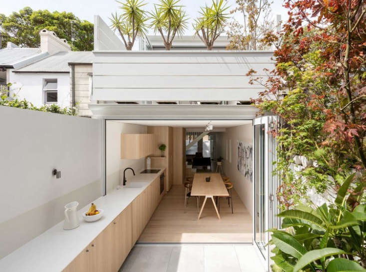 An architect-designed kitchen in a Sydney suburb features one long counter that stretches into a back patio. For more, see Kitchen of the Week: Indoor-Outdoor Cooking in Sydney.