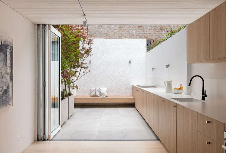 indoor outdoor kitchen design in a remodeled house in sydney by benn + penna ar 12