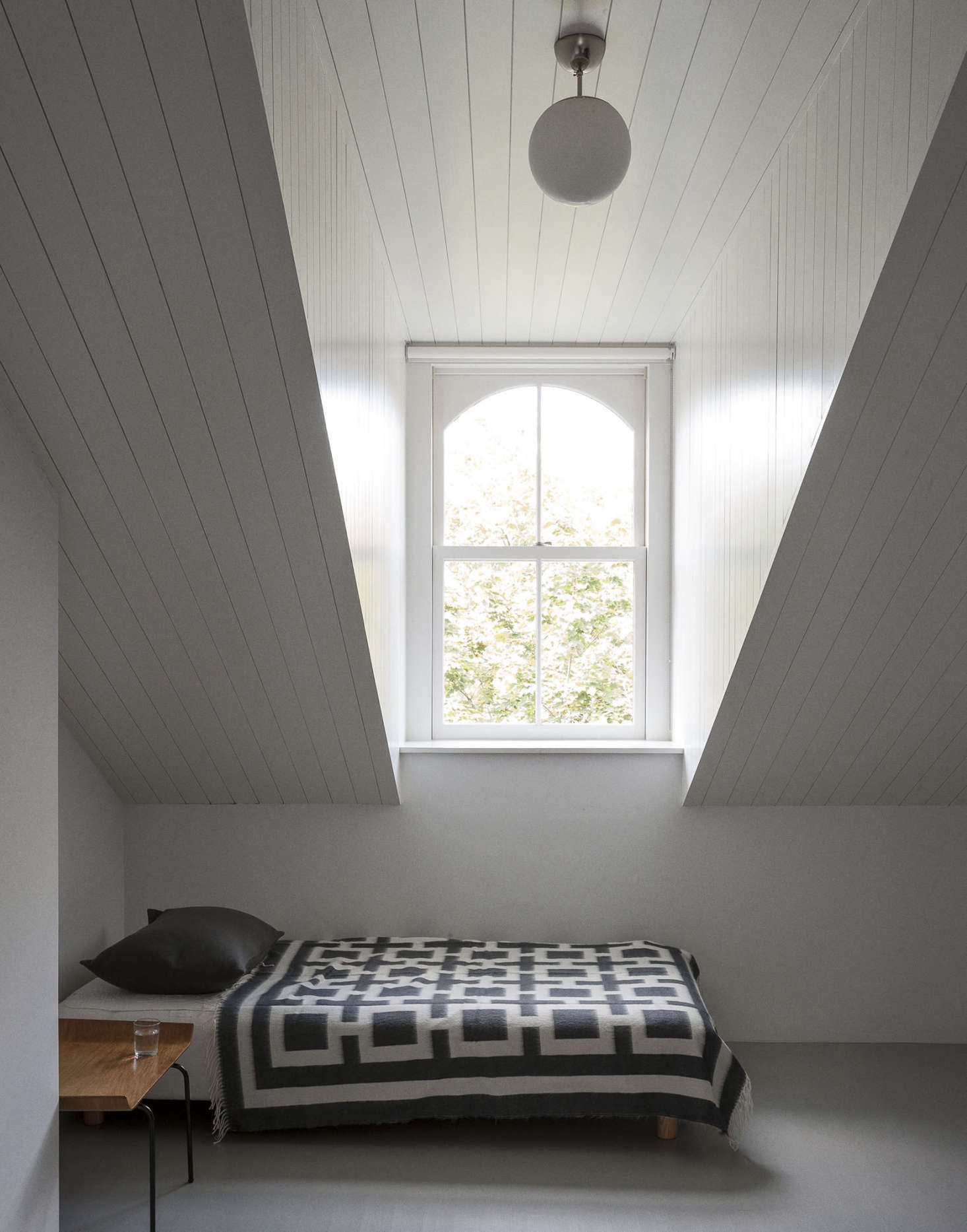 A black and white wool blanket in an attic room by architects Solveig Fernlund and Neil Logan. Photograph by Matthew Williams for Remodelista.