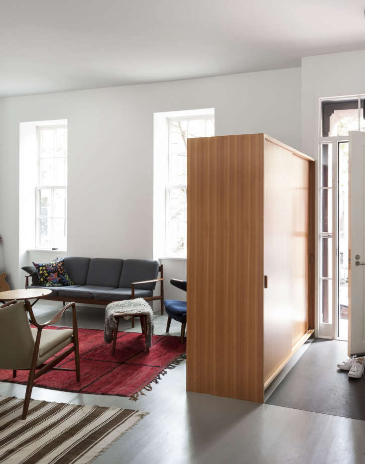 A freestanding cabinet serves as coat closet and room divider, creating a separate entryway of sorts. See more of this project inNordic Beauty: A Brooklyn Townhouse Reinvented with Style—and Restraint; photograph byMatthew Williamsfor Remodelista.