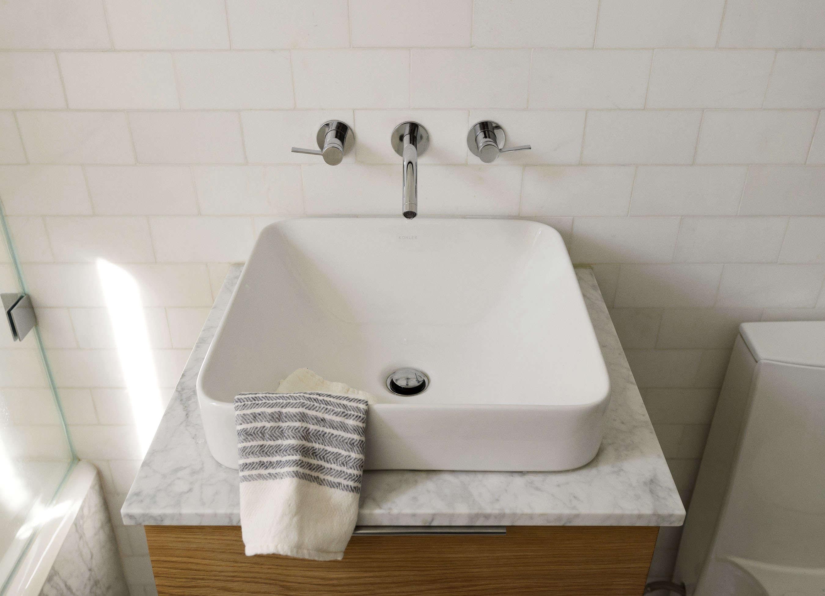 Square bathroom sink in Jacqueline-Schmidt and David Friedlander's 675-square-foot Brooklyn quarters, Matthew-Williams-photo | Remodelista