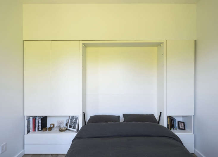 In another extra-tiny Brooklyn apartment, built-in cabinets and shelves make the most of the space around a pull-down Murphy bed. SeeLiving Large in 675 Square Feet, Brooklyn Edition for more; photograph byMatthew Williams.
