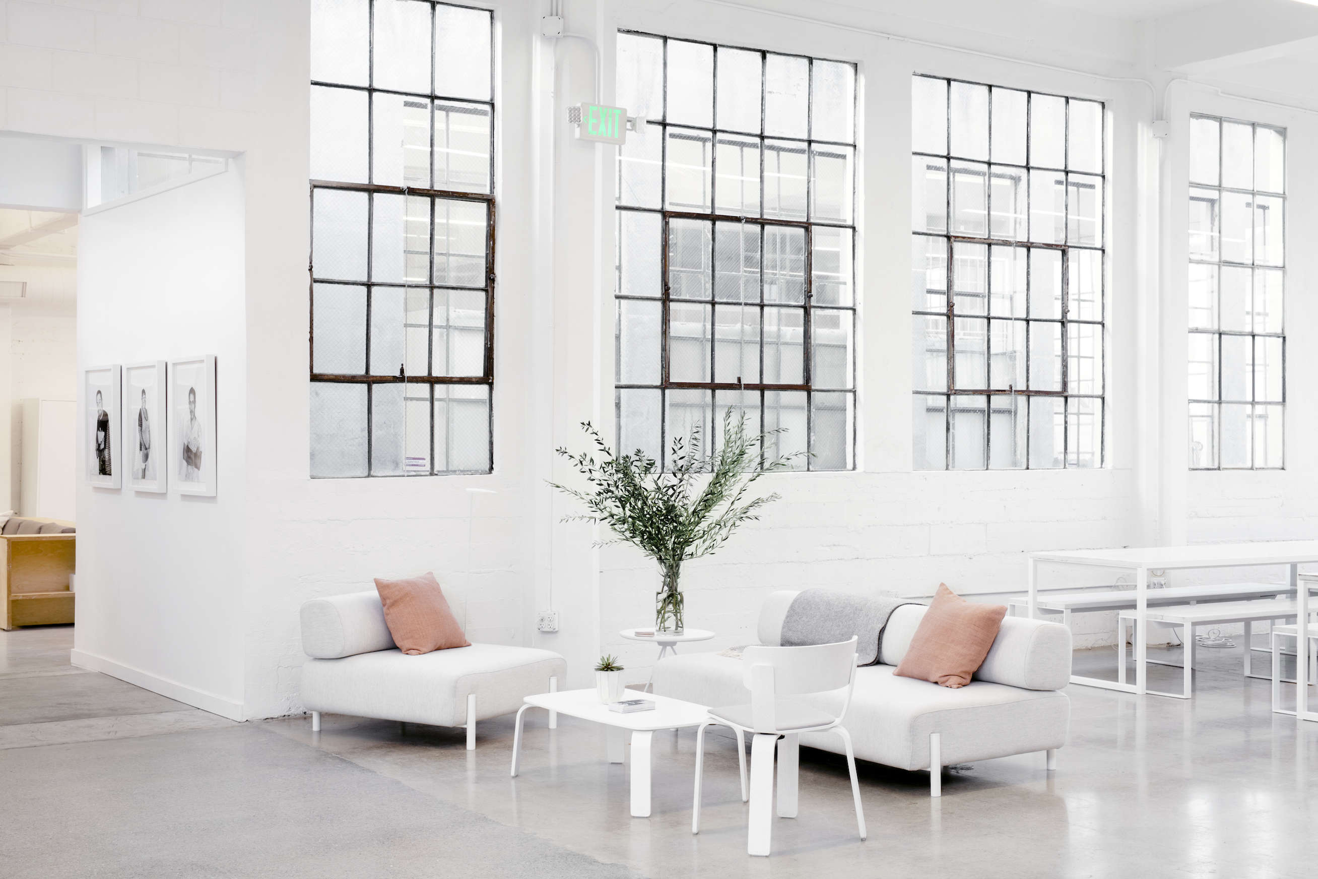 Modern white Scandinavian sofas in Everlane's lofty white office in SF, Carlos Chavarría photo | Remodelista