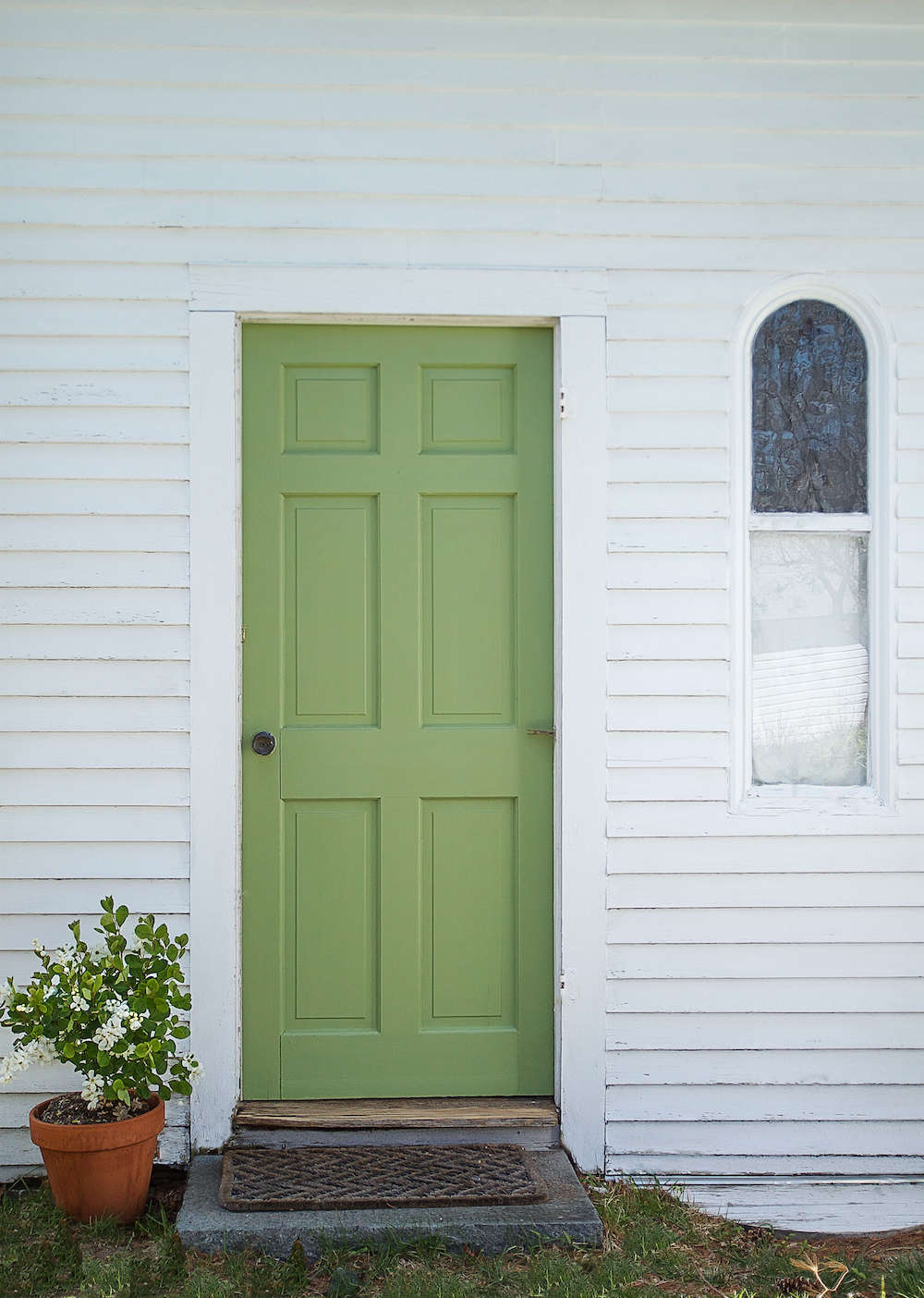 The front door of our guest cottage in Wellfleet; see A Spring Green Door with Farrow & Ball Paint.