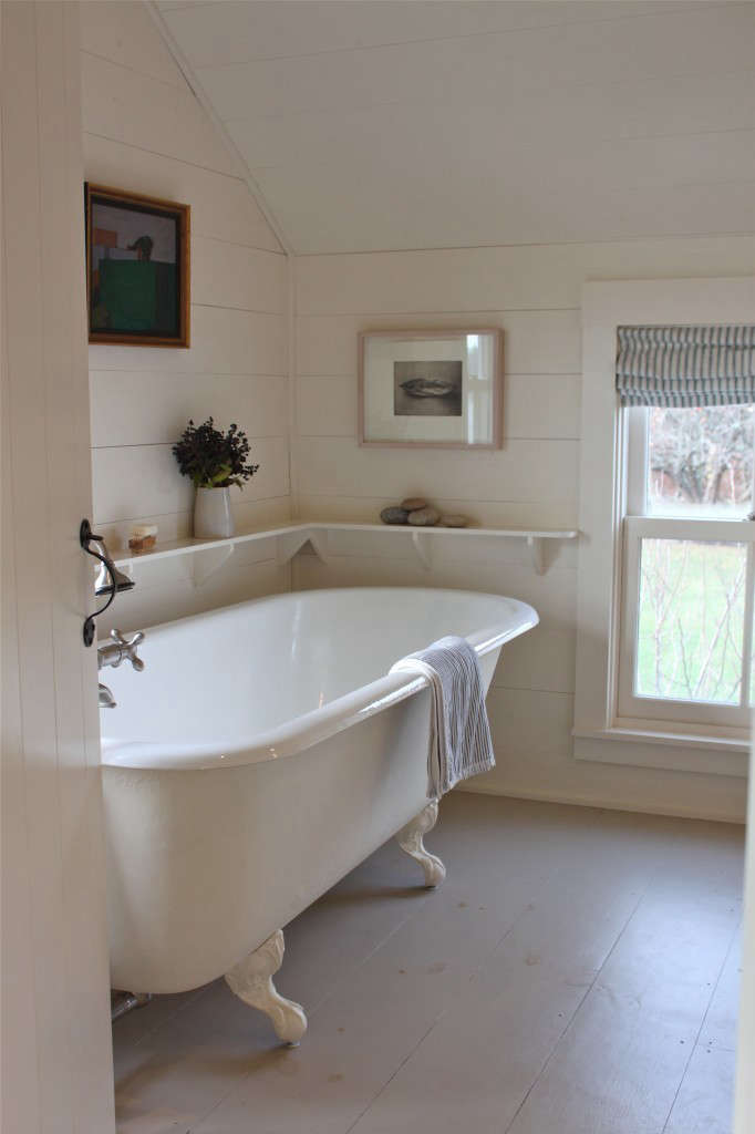 A claw-foot bath in A Cottage Reborn in Coastal Maine. Photograph by Justine Hand.