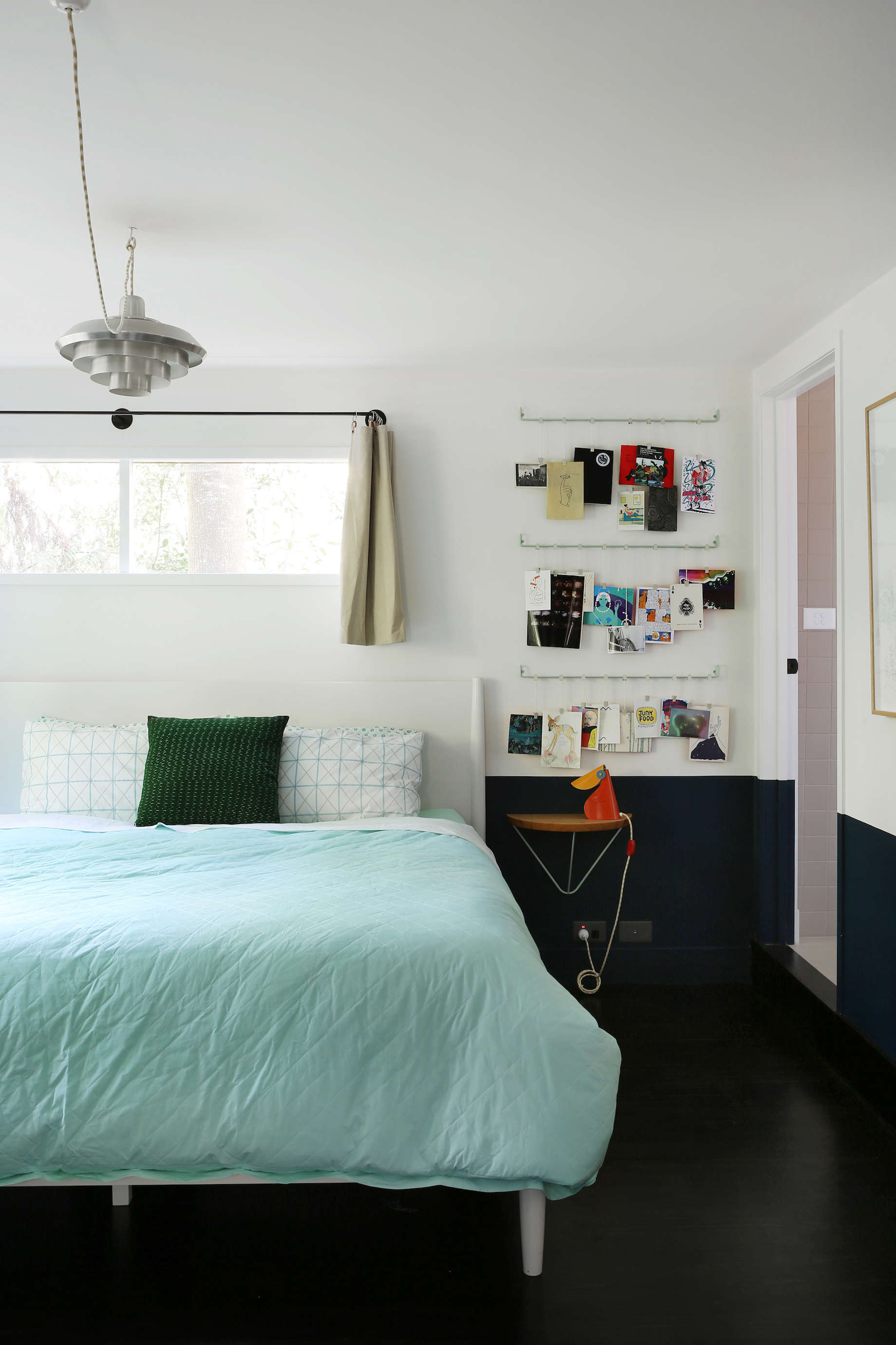 Guest room with hanging card rack at Jackie Winter Gardens, a guesthouse and artist residency outside Melbourne, Australia, designed by Searah Trotter of Hearth; Rhiannon Taylor photo| Remodelista