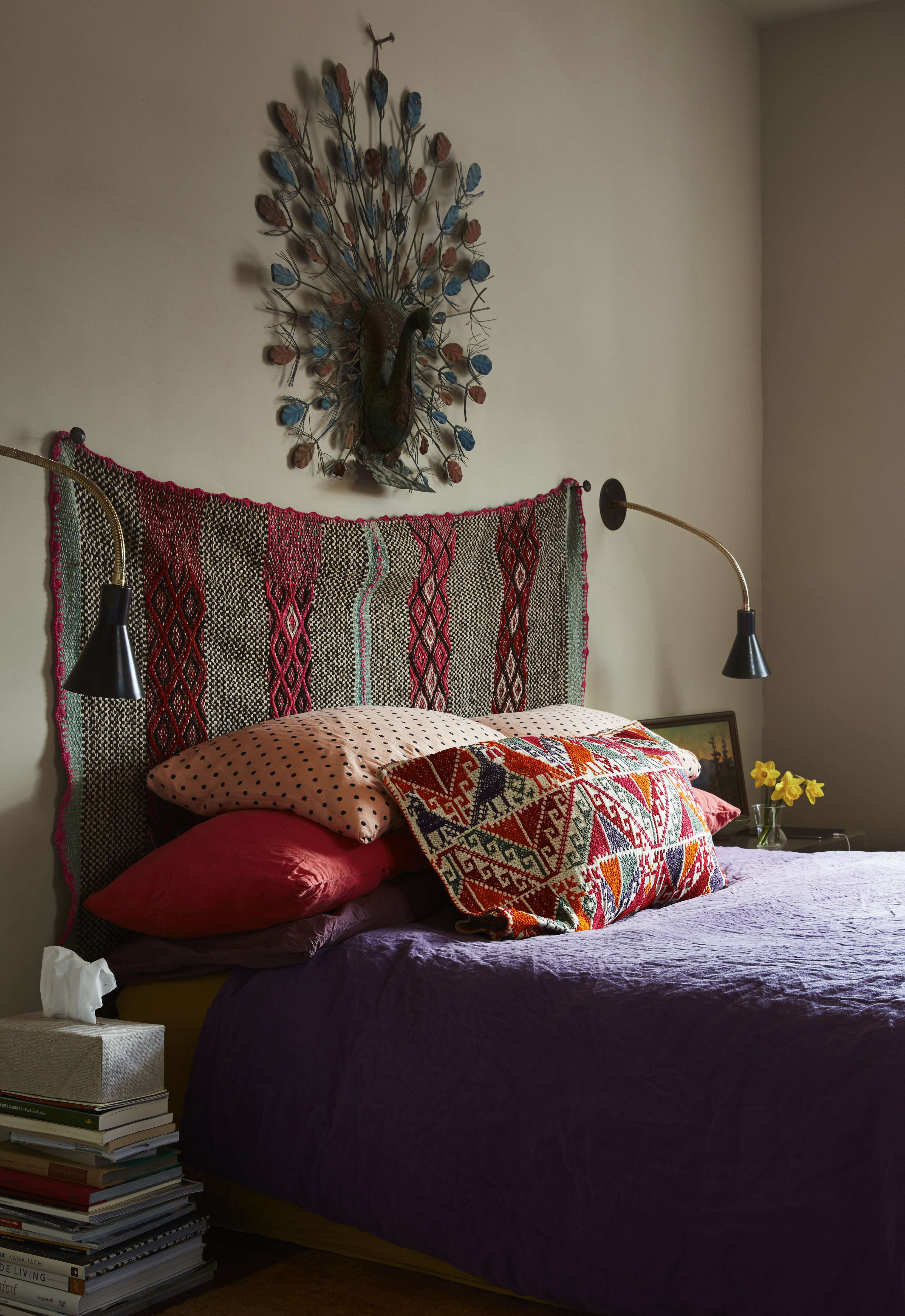 In the master bedroom, Livia hunganAndeanfrazadaas the headboard. The blue metal ostrich over it is one of Livia&#8