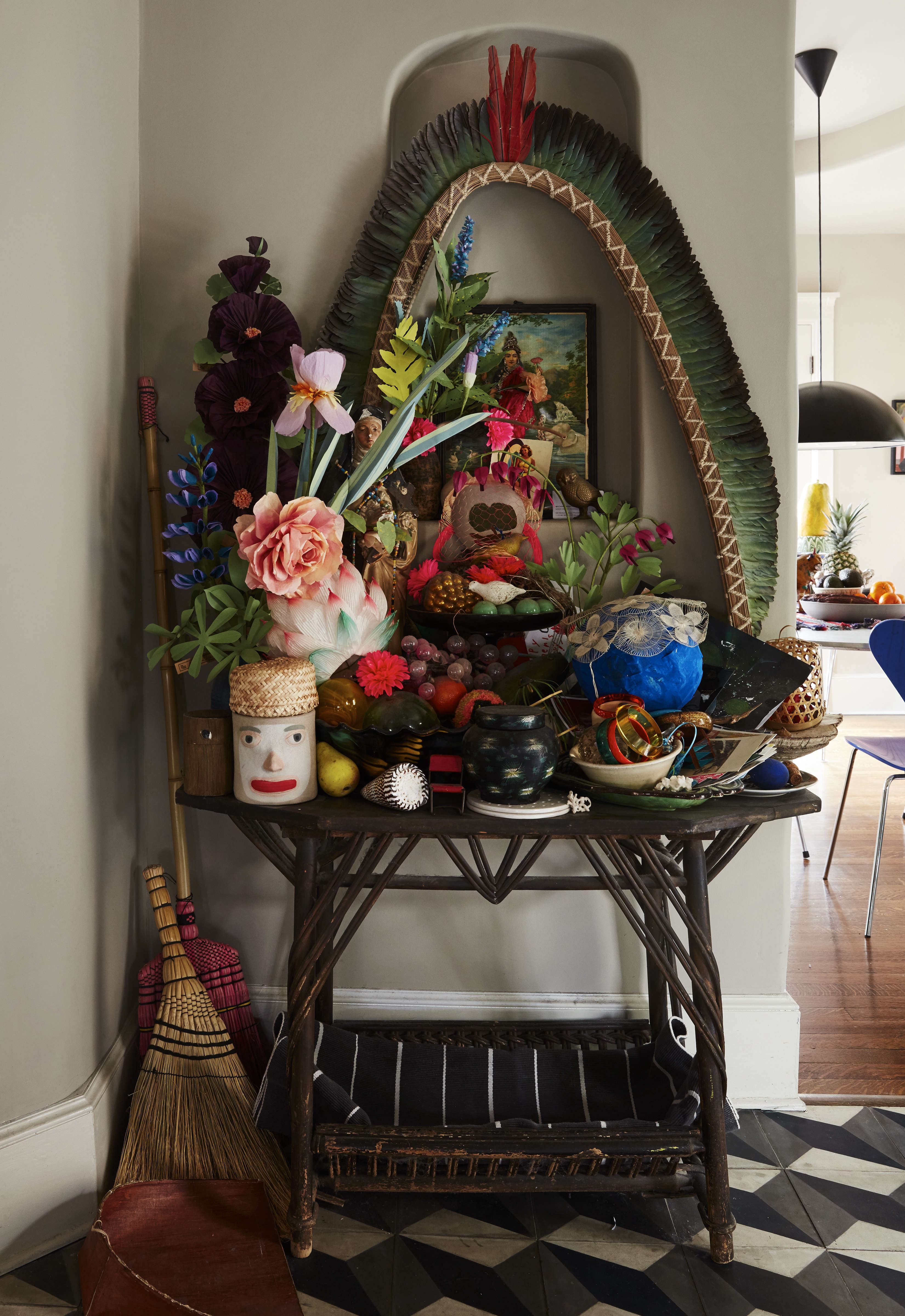 An ever-growing shrine rises in a recess that Danny built between the kitchen and living room. It&#8
