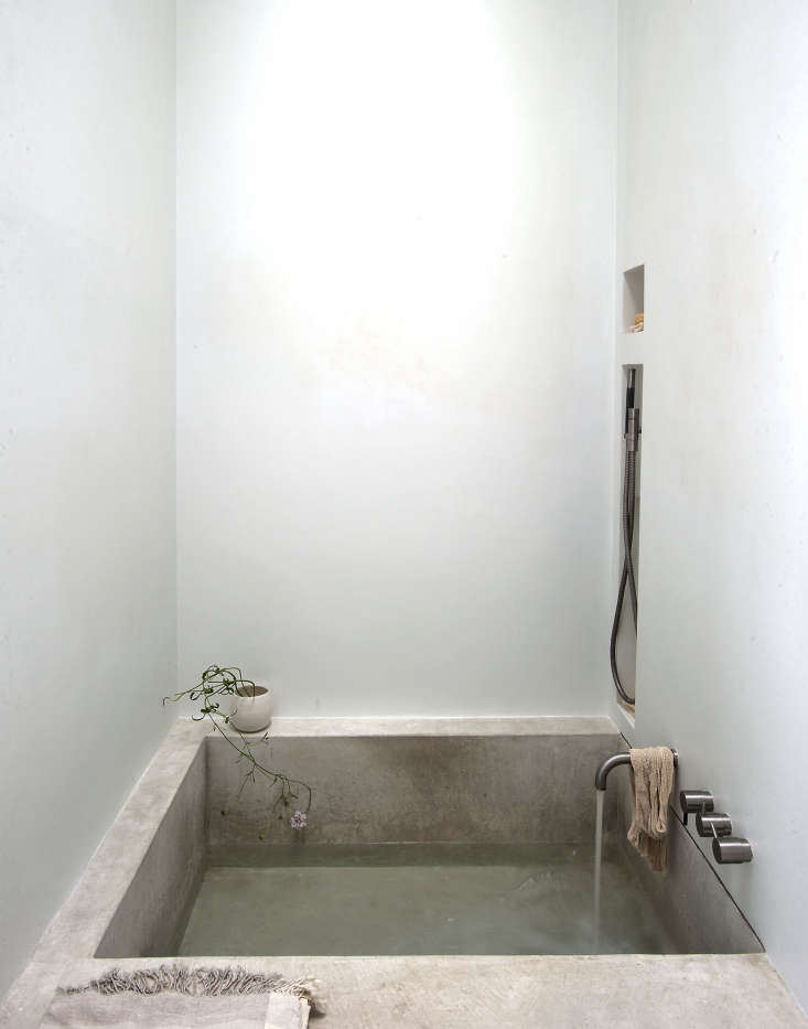 Remodeling 101 The Cult of the Concrete Sink And, if you feel moved, concrete can also make a sculptural bath, as seen here inWorld's Tiniest Spa Bath: A Grecian Inspired Guest Suite in LA.Photograph byMatthew Williamsfor Remodelista.