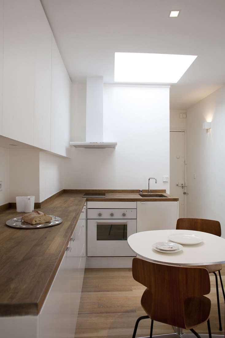 French architect Philippe Harden designed a small apartment kitchen in Montparnasse, Paris, with Ikea cabinets (and doors) and Ikea butcher block countertops stained, he says, &#8