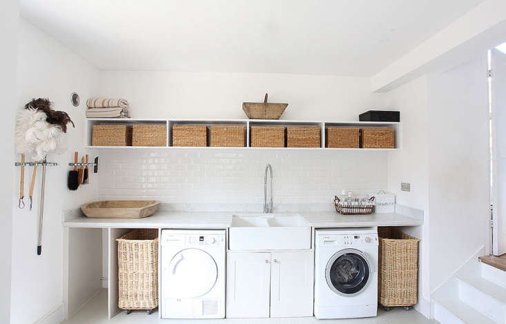 This airy laundry room has storage to spare. See Steal This Look: A Well-Equipped Laundry Room in Somerset to find similar products. Photograph courtesy of Light Locations.