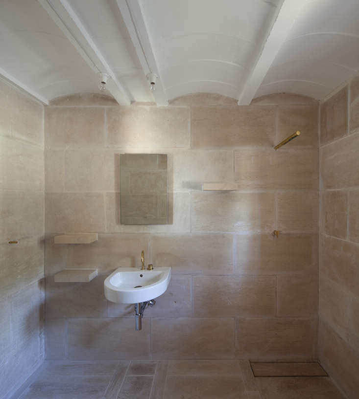 a serene bath stays cool withminimal fixtures andsimple stone. see more of  14