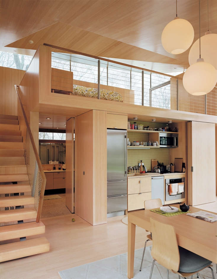 a small kitchen concealed behind folding doors in a project by gray organschi a 20