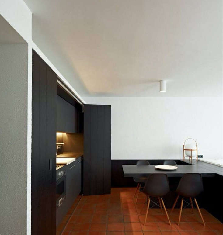 A minimalist kitchen in an apartment in Cadaqués, Spain, designed by Francesc Rifé Studio. Photograph courtesy of Francesc Rifé Studio.