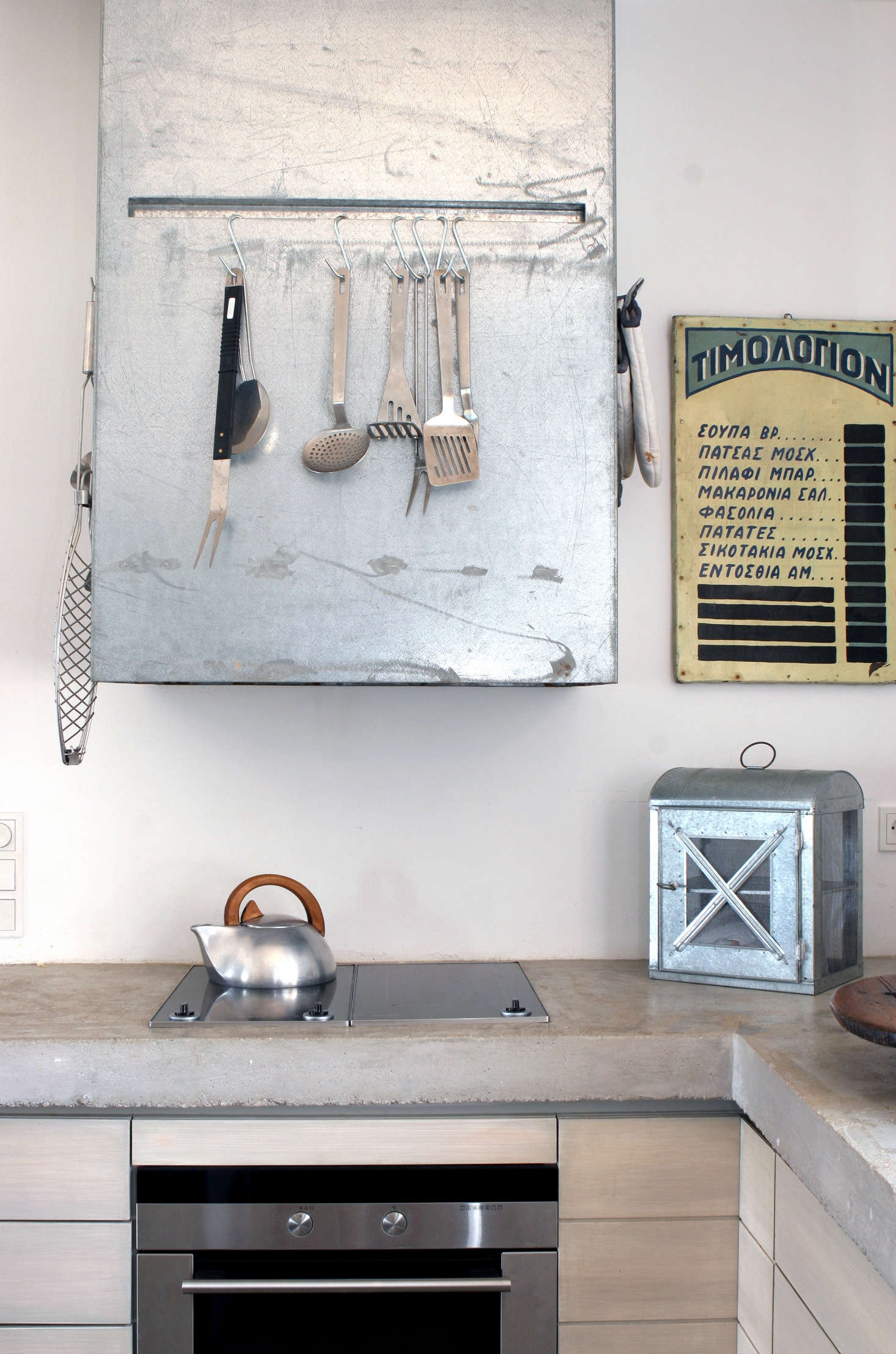 A wall-mounted range hood inKitchen of the Week: A Greek Architect's Ode to Minimalism.