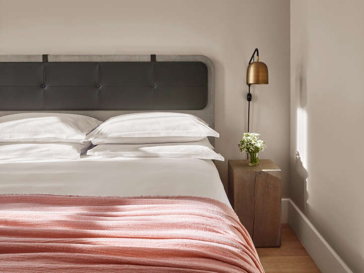 Another pinkish hotel guest room, at loading=