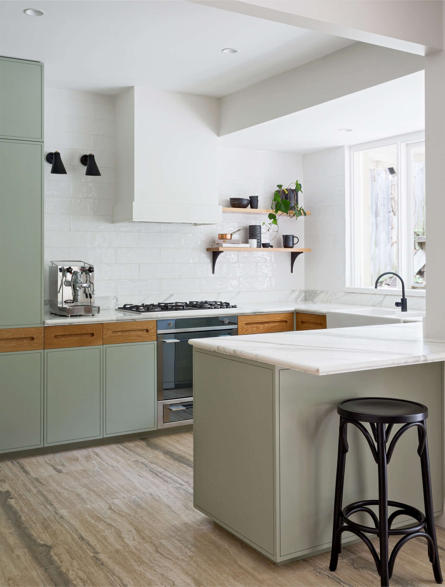 A clean and fresh-looking kitchen remodel with sage kitchen cabinets, Calacatta marble counters, and handmade subway tiles by interior designers Arent & Pyke of Sydney | Remodelista