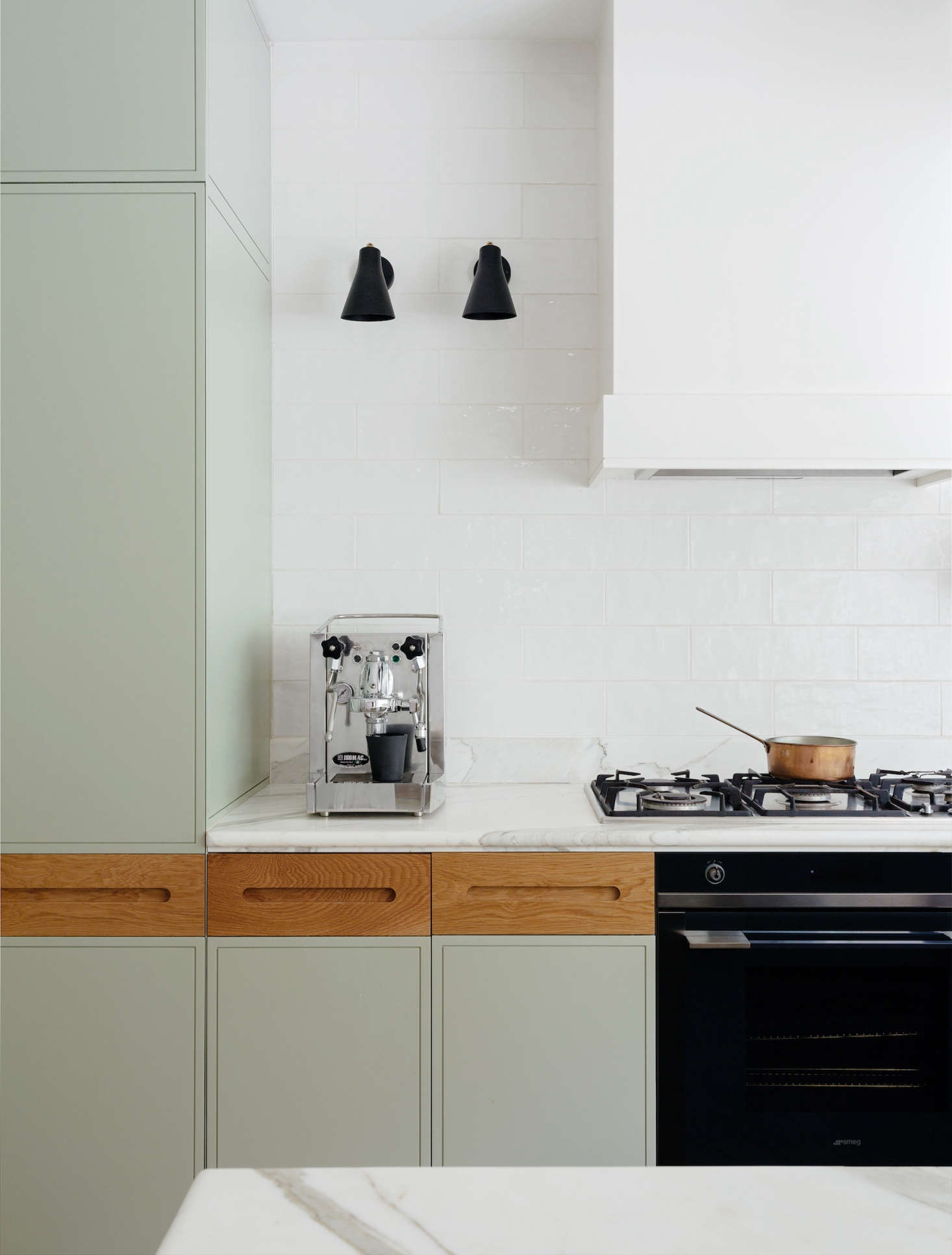 A clean and fresh-looking kitchen remodel with custom sage cabinets and oak pulls, Calacatta marble counters, and handmade subway tiles by interior designers Arent & Pyke of Sydney | Remodelista