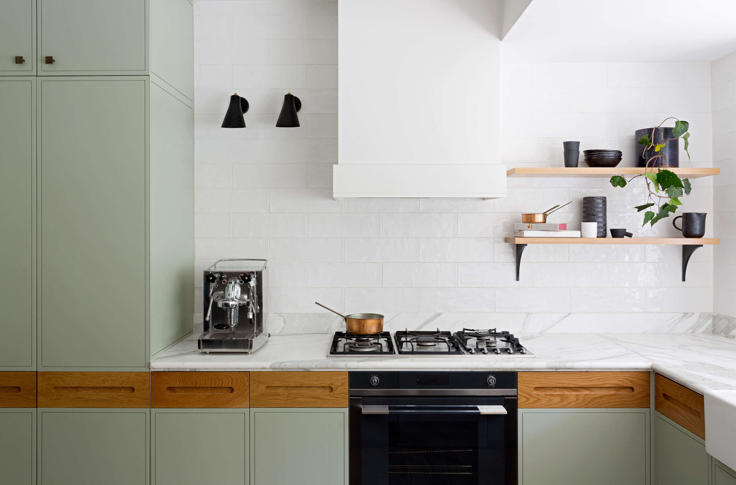 A clean and fresh-looking kitchen remodel with custom cabinets (painted sage with solid oak insets), Calacatta marble counters, and handmade subway tiles by interior designers Arent & Pyke of Sydney | Remodelista