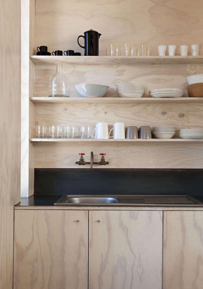 Plywood kitchen in Scarborough South-Africa beach cabin designed y Beatty Vermeiren-architects | Remodelista