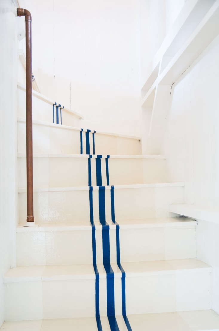 Remodeling 101 All About Stair Runners A stair runner alternative, on the cheap. For more, seeRemodeling \10\1: Nautical Stripes on the Stairs.