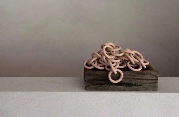 Pale pink ceramic chain sculpture by New York artist Shelley Marcus Sonenberg | Remodelista