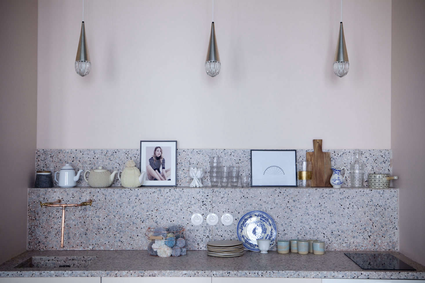 "The countertops and backsplash are made of terrazzo slab. Says Sandrine: ""It's less expensive than marble, and you can choose the color you want and also the size of the stone shards."" Photography by Julie Ansiau, courtesy of Marie-Sixtine."