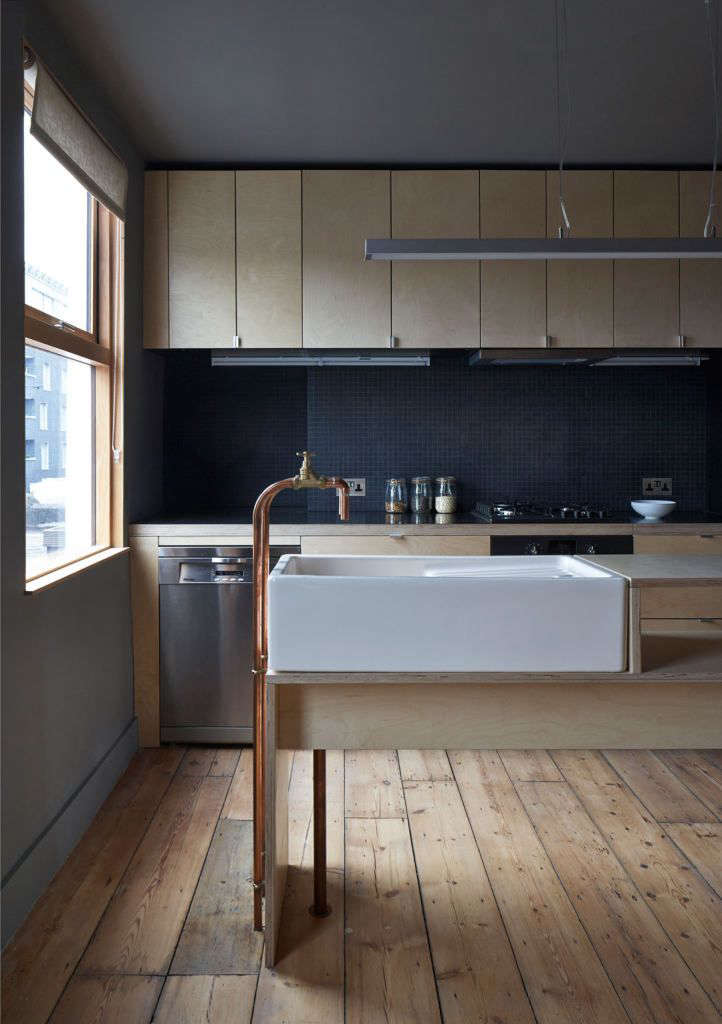 Kitchen with DIY standing copper faucets by architect Jonathan Tuckey | Remodelista