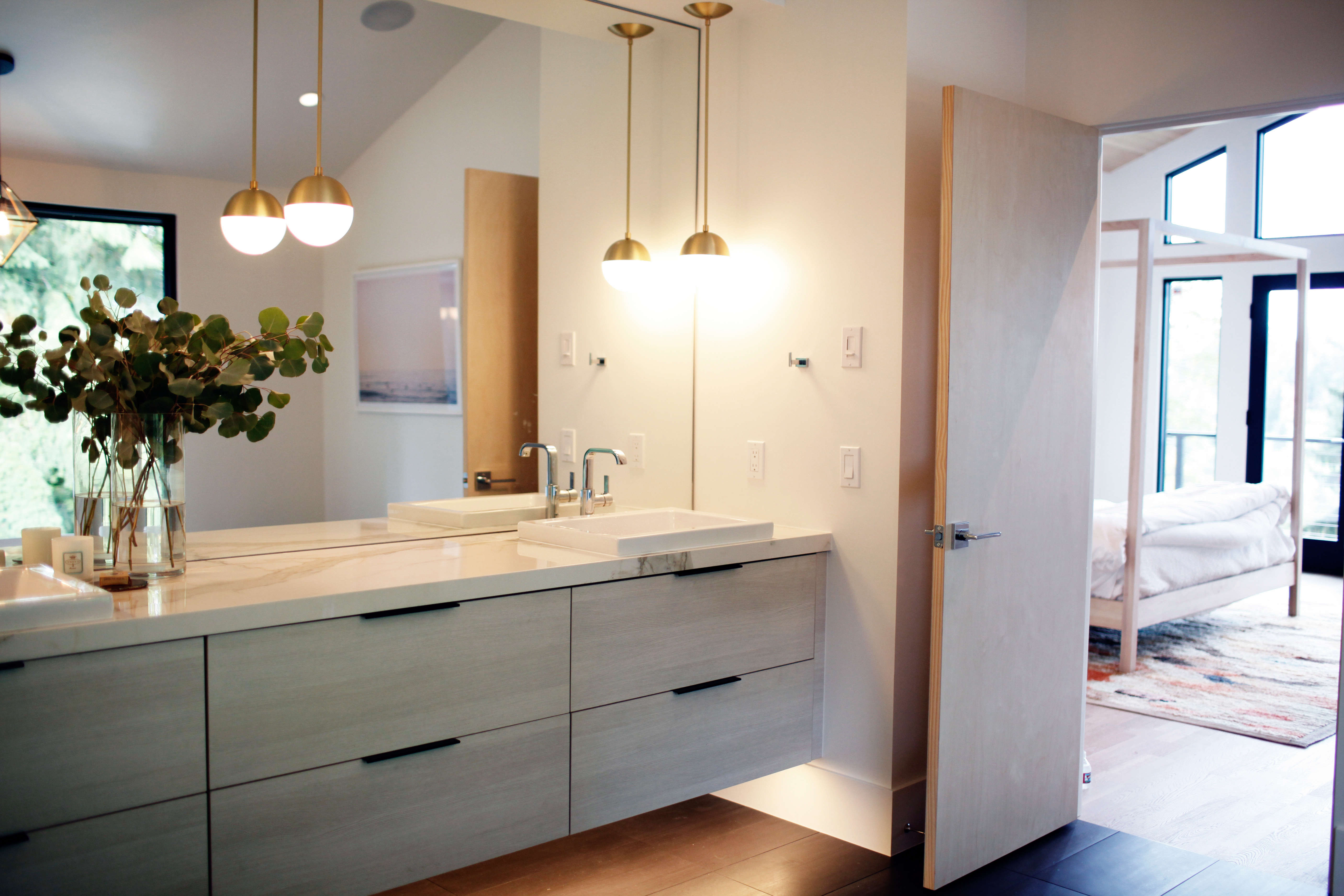 master bath with marble counters in a remodeled ralph anderson 1966 home in bel 22