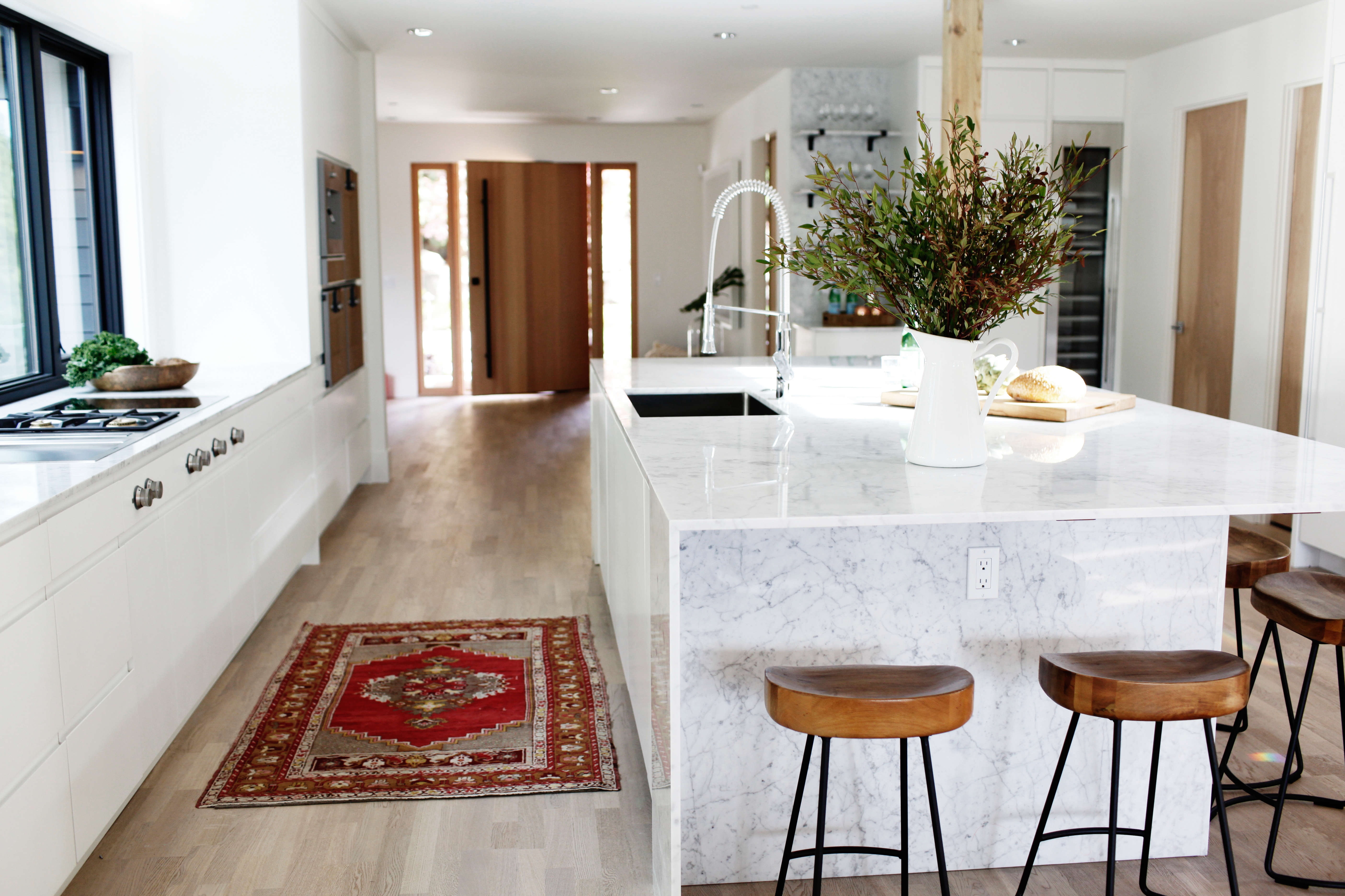 kitchen with marble island with waterfall counter in a remodeled ralph anderson 14