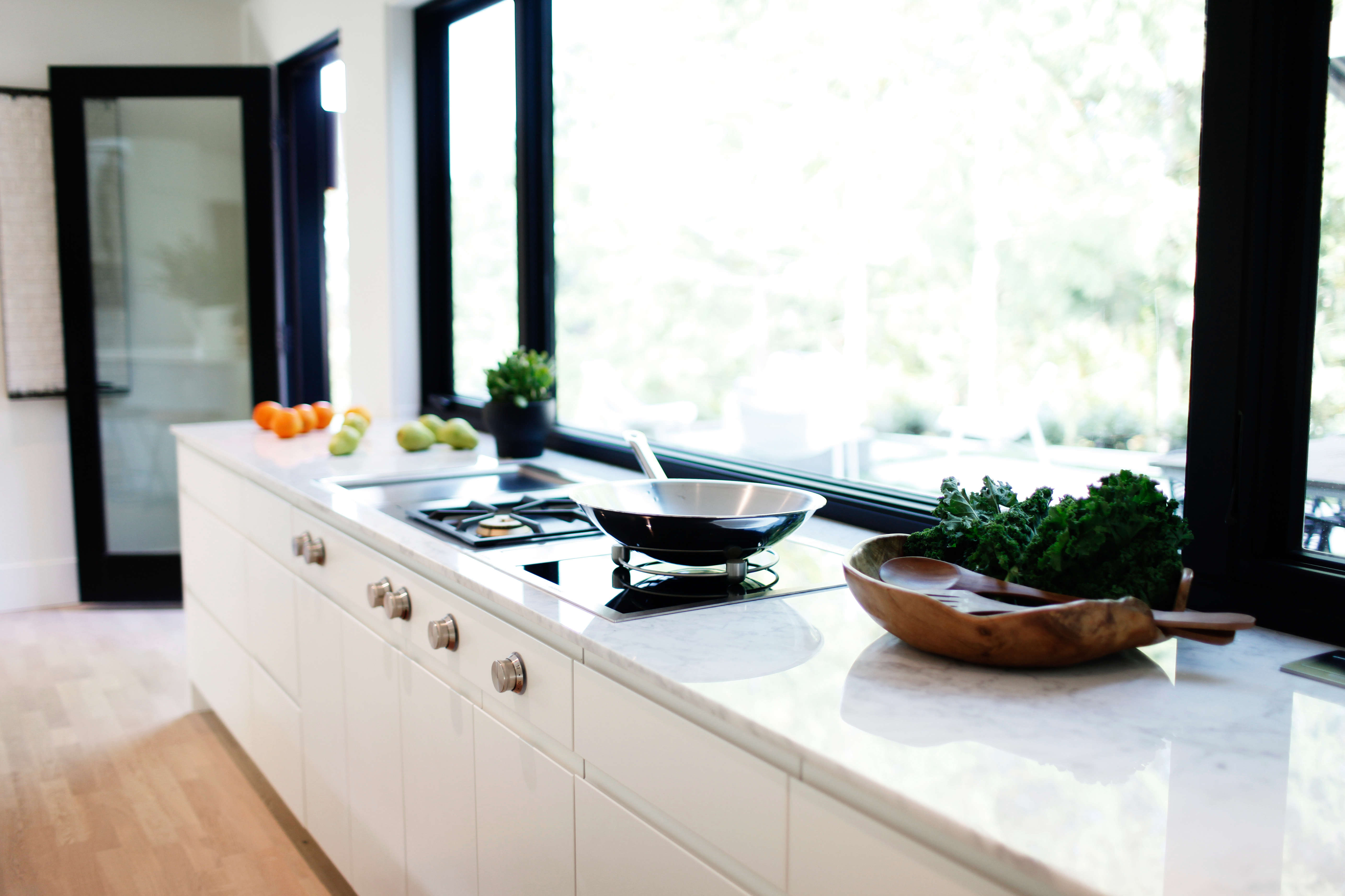 kitchen with marble counters and gaggenau appliances in a remodeled ralph ander 15