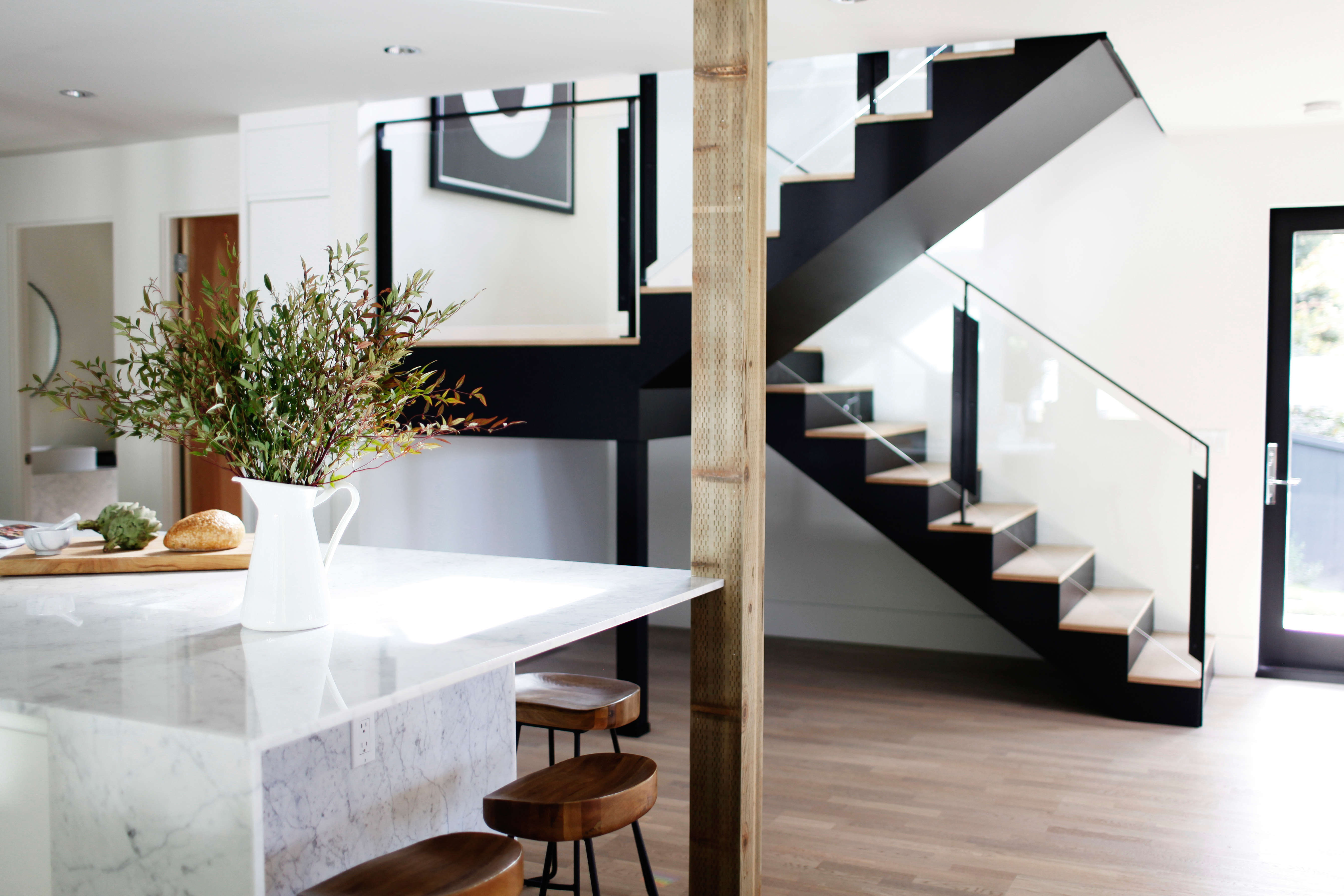 new glass and steel lookalike stair in a remodeled ralph anderson 1966 home in  16