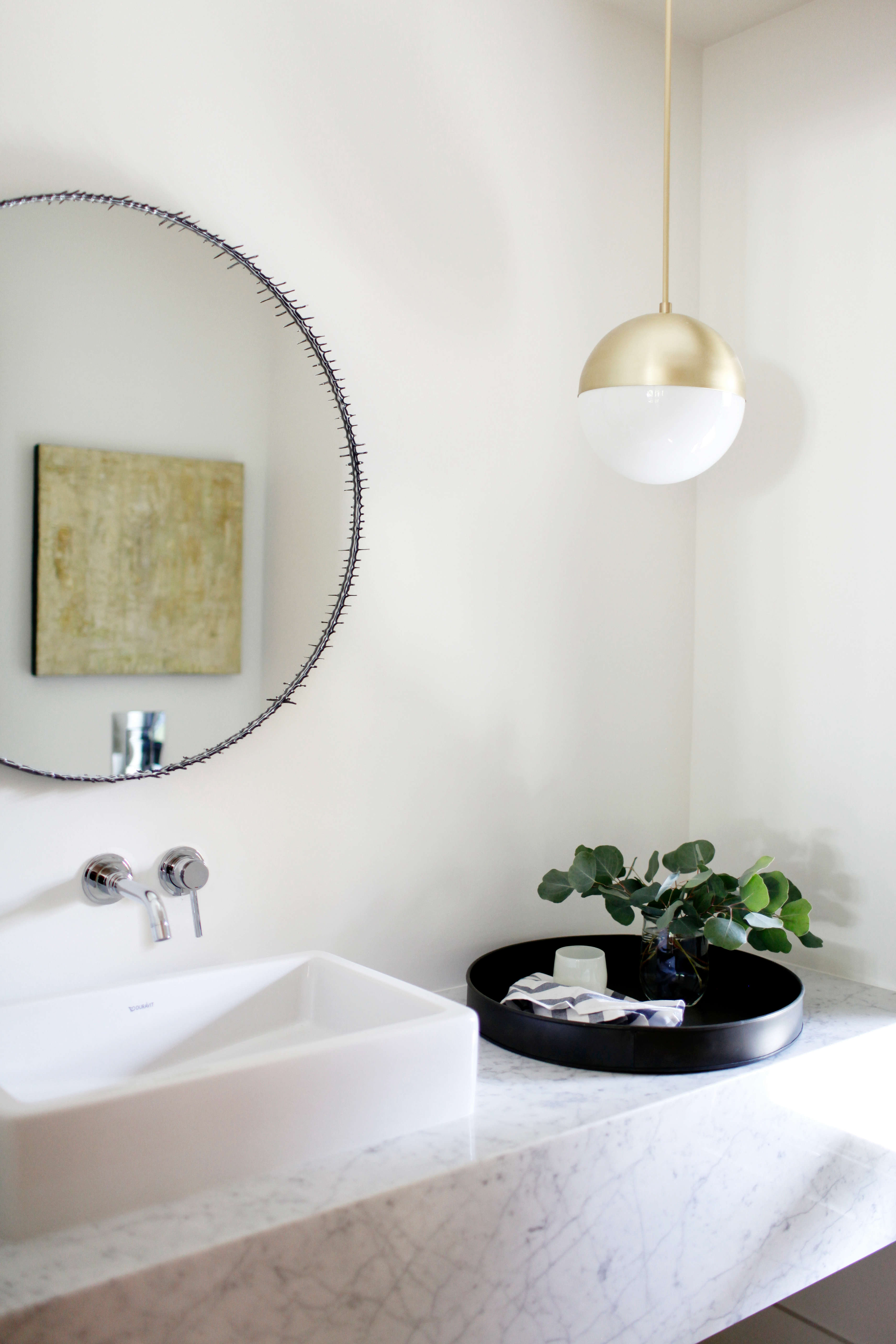 marble and brass powder room in a remodeled ralph anderson 1966 home in bellevu 18