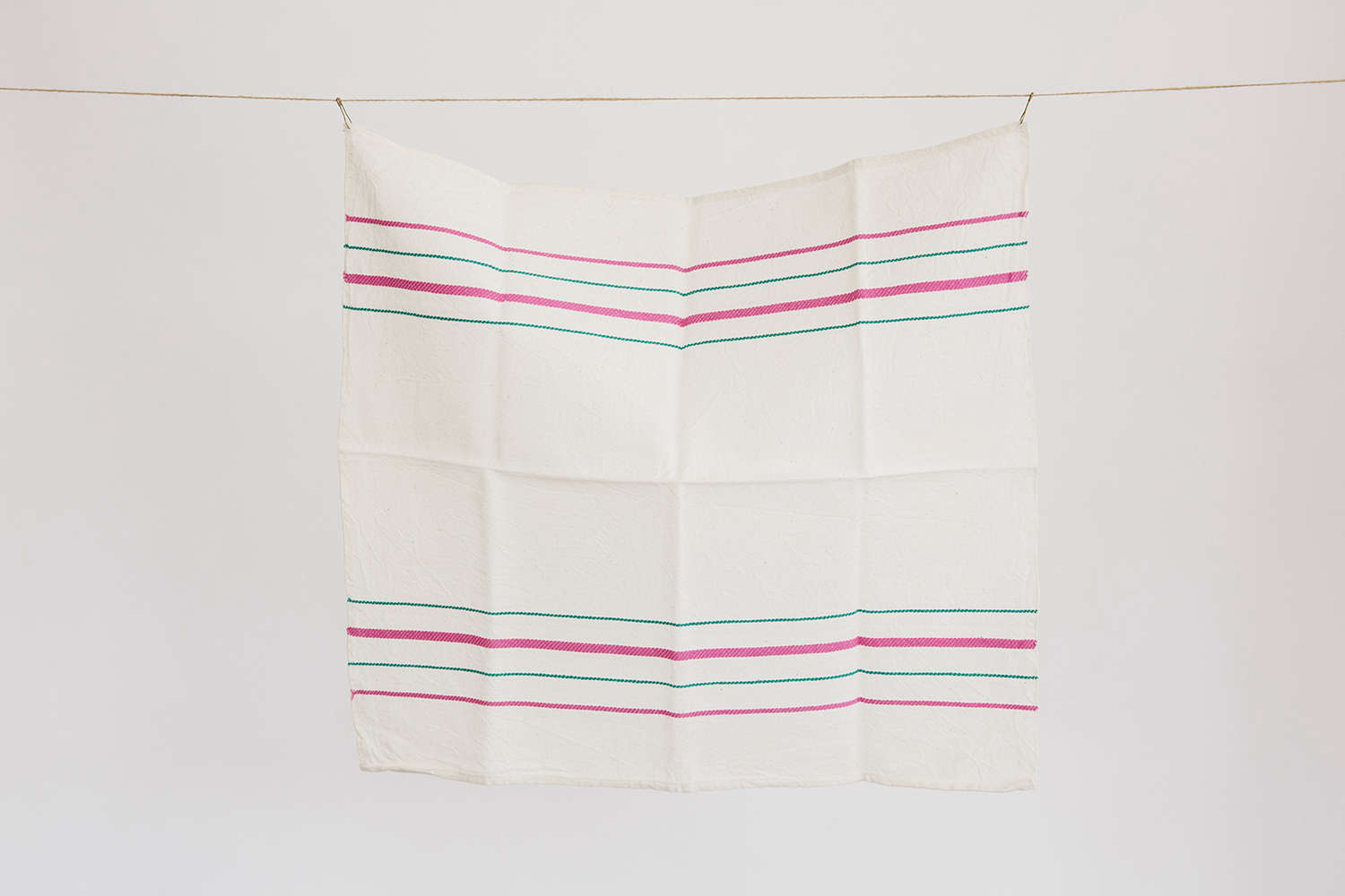 Pink and green striped white linen towel set at Housewares store Set and Co. in Dallas| Remodelista