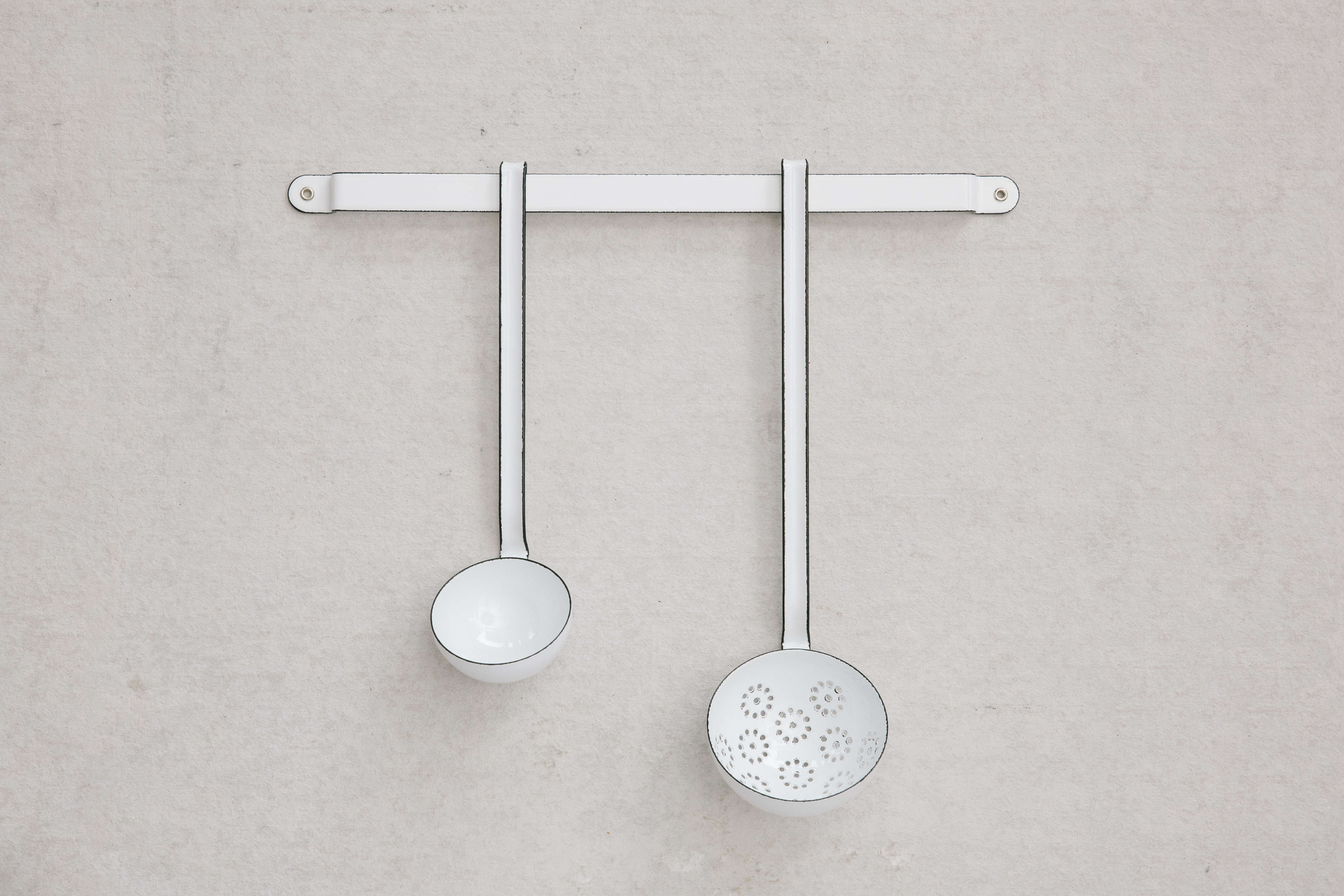 Enamelware ladles on hanging rack from housewares store Set and Co. in Dallas| Remodelista