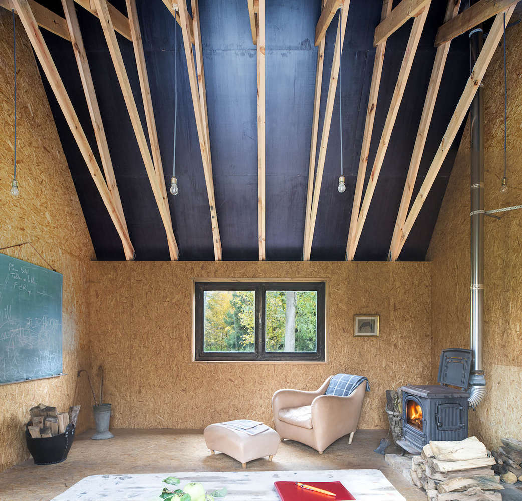 soaring interior of a cabin in belgium designed and built by london architectur 16