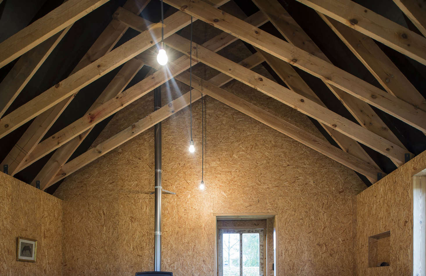 Scissor trusses in a cabin in Belgium designed and built by London architecture firm De Rosee Sa Architects   Remodelista