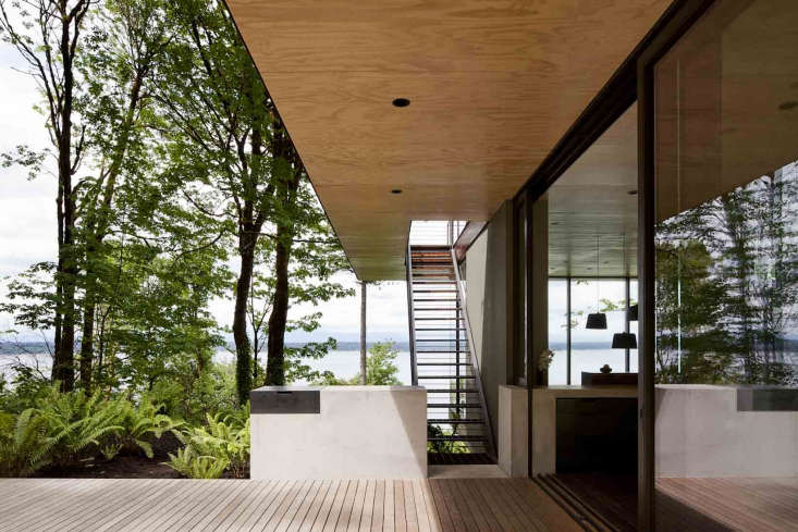 A Puget Sound Cabin That Rests Lightly on the Landscape The cantilevered roof serves as a dramatic viewing deck to the Puget Sound and the Olympic mountains. The steel stair leading to the roof is perforated for drainage.
