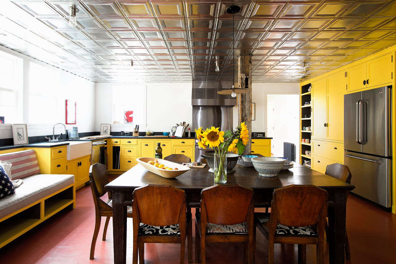Thecabinets are paintedBabouche from Farrow & Bal. The dining table is a family heirloom.