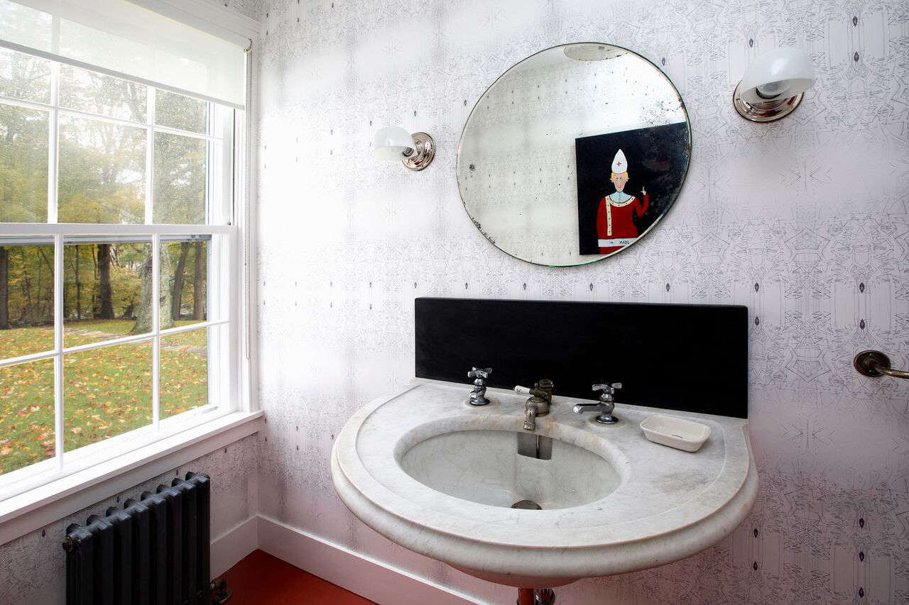 A bathroom with a vintage marble sink.