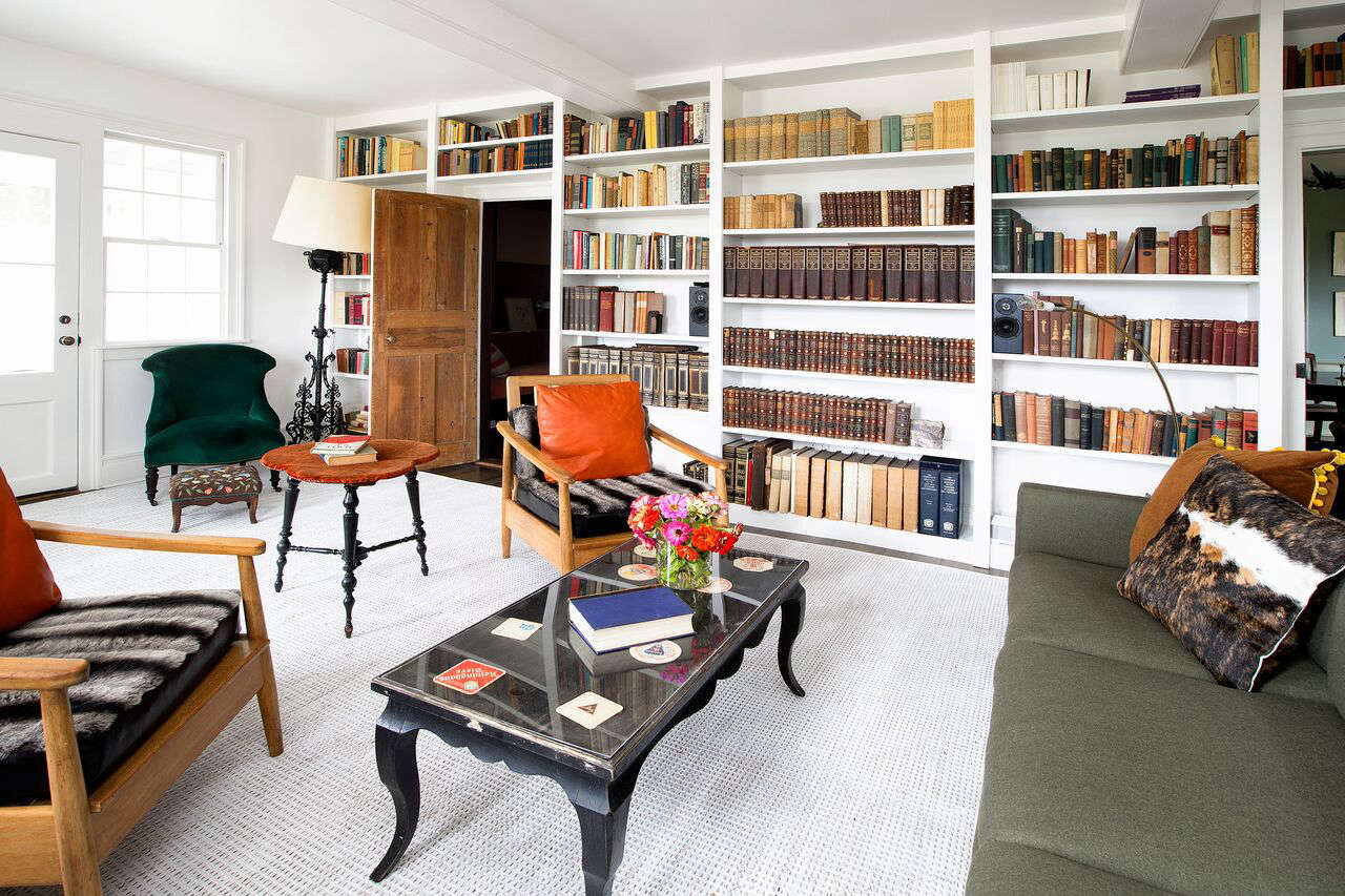 Bold Color in a Connecticut Country House The wife, an editor at theParis Review, collects books and antique textiles. The sofa fabric is Fern wool flannel fromHolland & Sherry.