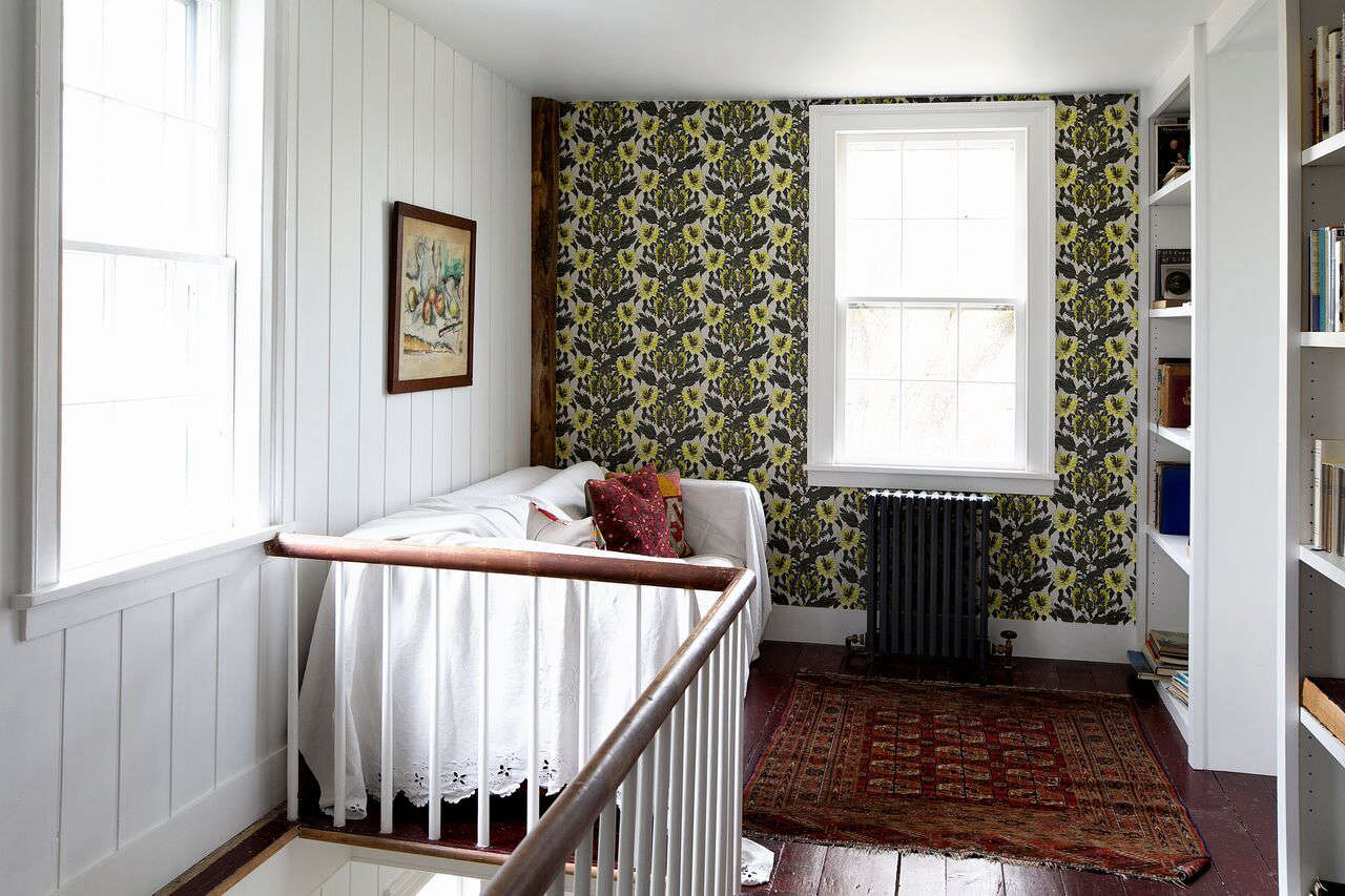 The hallway is papered in Lady Green wallpaper (&#8