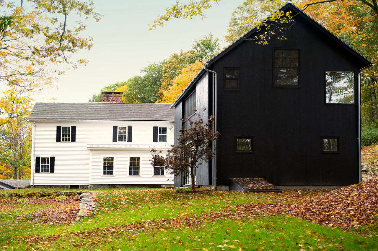 Wright added a modern black barn, which houses a rec room on the lower level and the master suite on the second story.