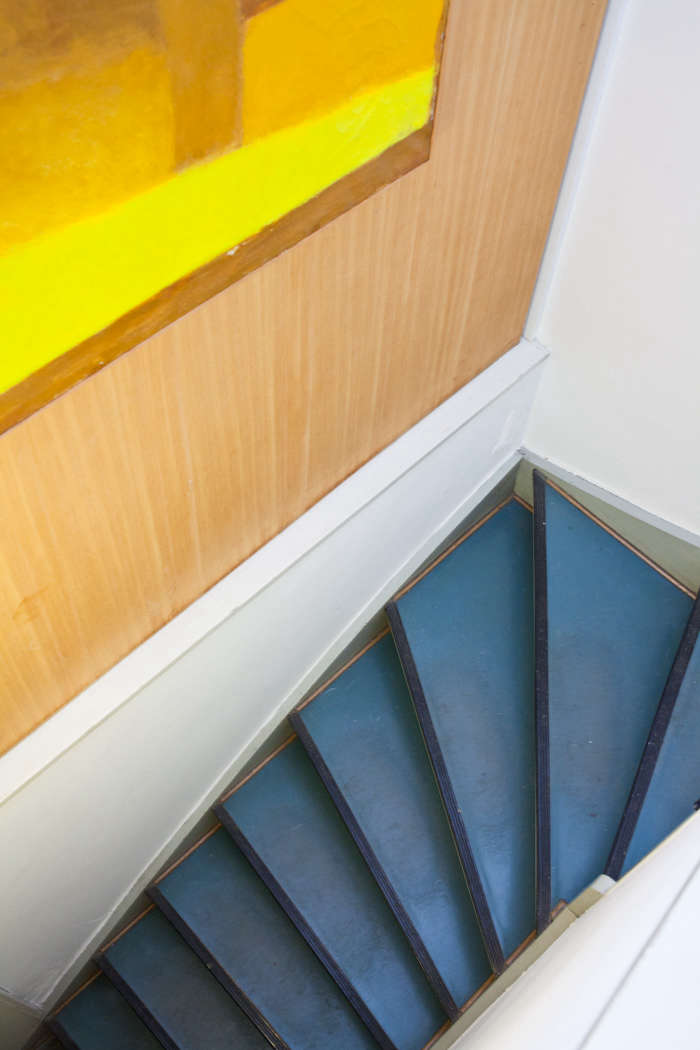 Stairs painted in true blue (Blue Macaw from Benjamin Moore) with a dark royal trim (see Stiffkey Blue from Farrow & Ball).