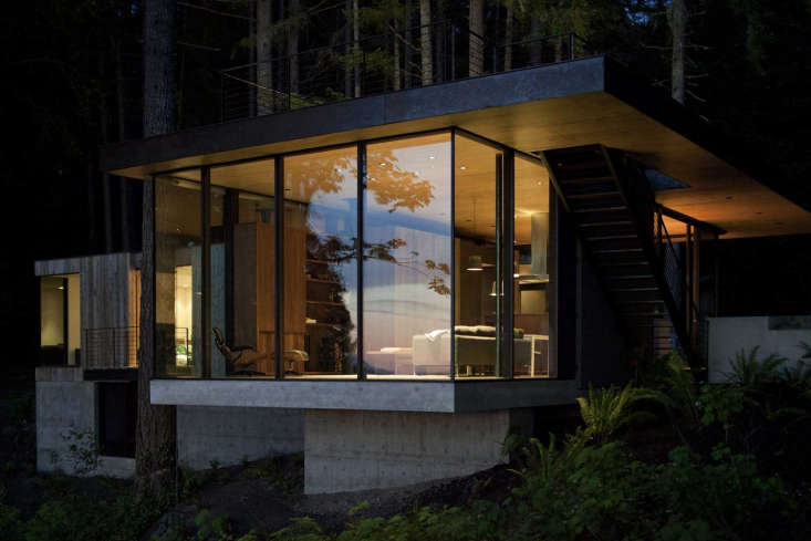 A Puget Sound Cabin That Rests Lightly on the Landscape At night the cabin glows like a lantern. The architects smartly tucked two small bedrooms and a shared bath into the house&#8\2\17;s concrete foundation, for use by the couple&#8\2\17;s adult children andovernight guests.
