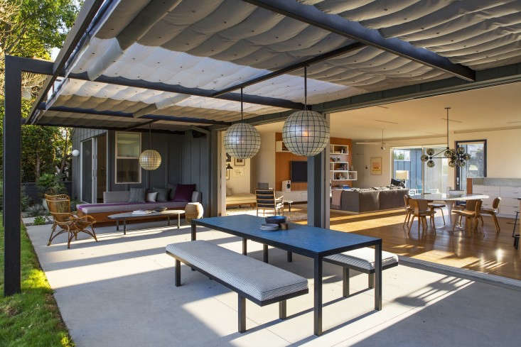 At An LA Ranch Rehab by Barbara Bestor and DISC Interiors, the entire living space, kitchen included, extends into an outdoor living and dining area.