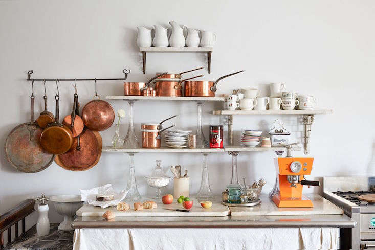 A practical use for multiple small scraps: open kitchen shelving (supported by sturdy brackets), as seen inA Historical Hudson, NY, Home Reimagined (European Antiques Included).