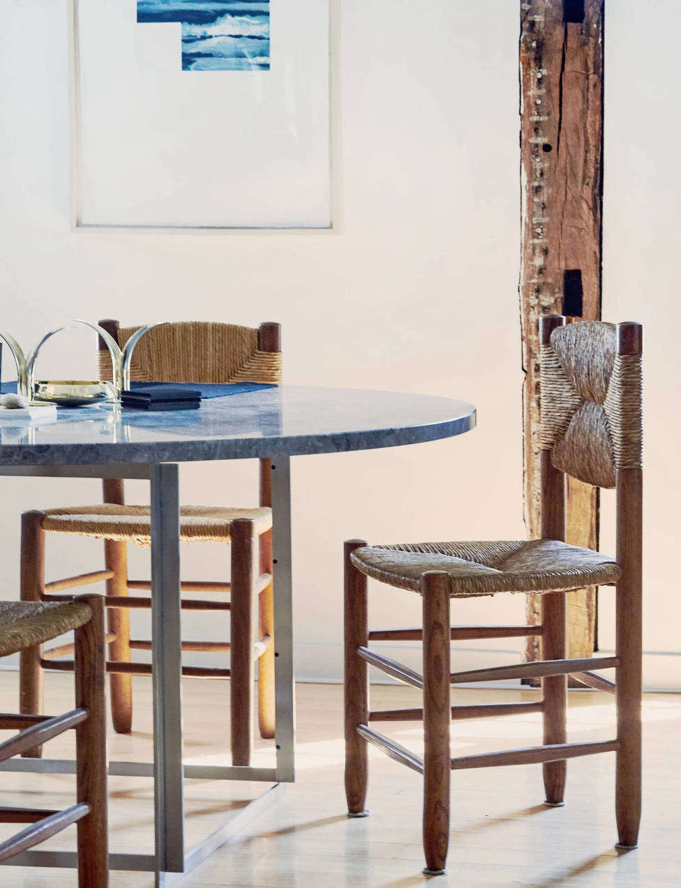 woven farm chairs at the line amagansett, a fashion and design shop in a fully  15